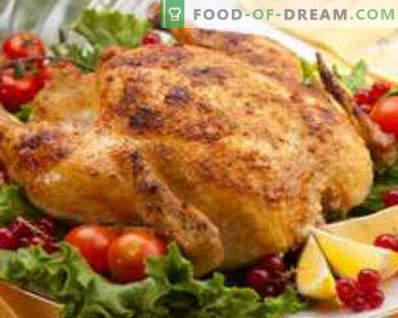 Pollo relleno de manzanas en el horno, entero, con naranjas, trigo sarraceno