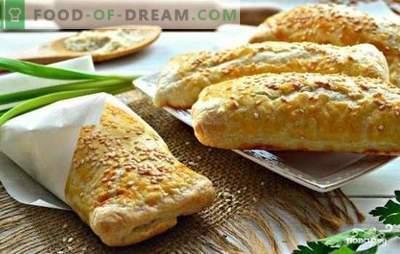 Samsa mit Kartoffeln - eine Torte mit ihren Geheimnissen. Hausgemachte Samsa mit Kartoffeln und Hühnchen, Zwiebeln, Fleisch, Käse