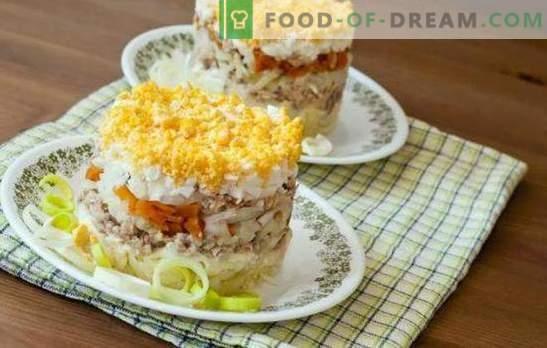 La ensalada de pescado con huevo es un plato festivo jugoso. Una selección de ensaladas de pescado originales con huevo, verduras, legumbres y frutas