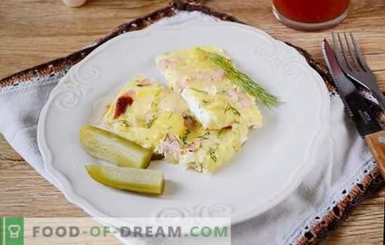 Papas hervidas con un huevo en una sartén - un plato nutritivo de