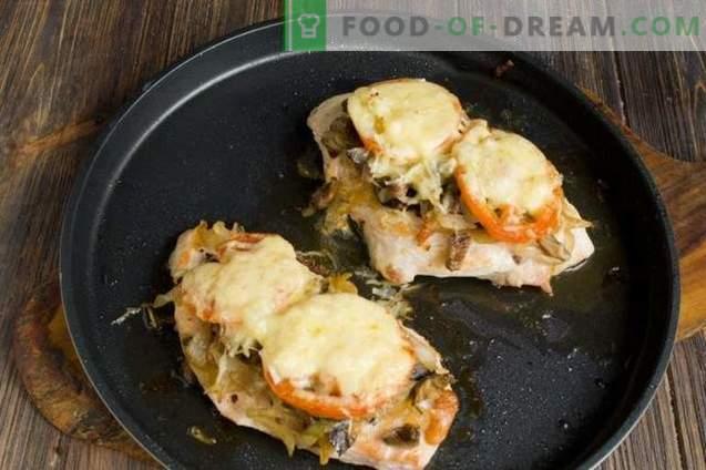 Chuletas de pollo con queso y tomates